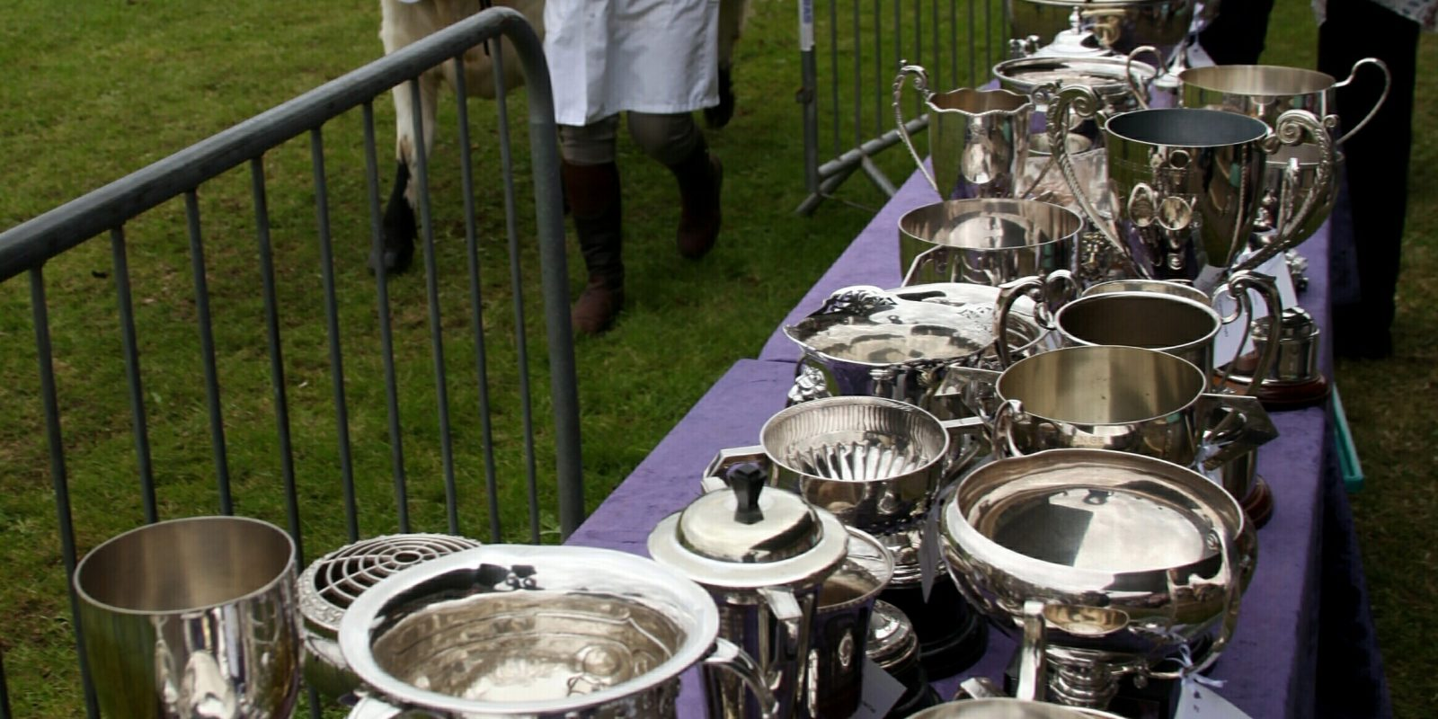The parade makes its way past the fine display of trophies at Dumfries Show